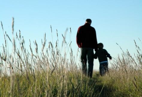 father-son-walking-field
